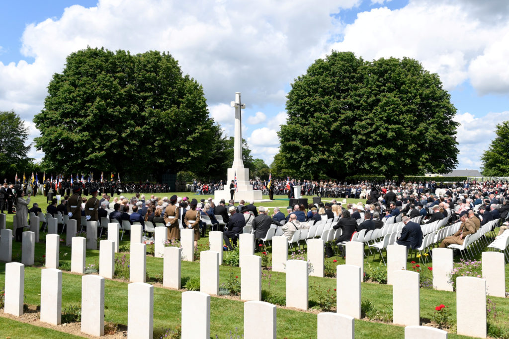 Guests attend a Service of Remembrance at the Commonwealth War Graves Cemetery in Bayeux for the 75th anniversary of D-Day, Normandy, northwestern France, June 6, 2019. Bertrand Guay/Pool via REUTERS
