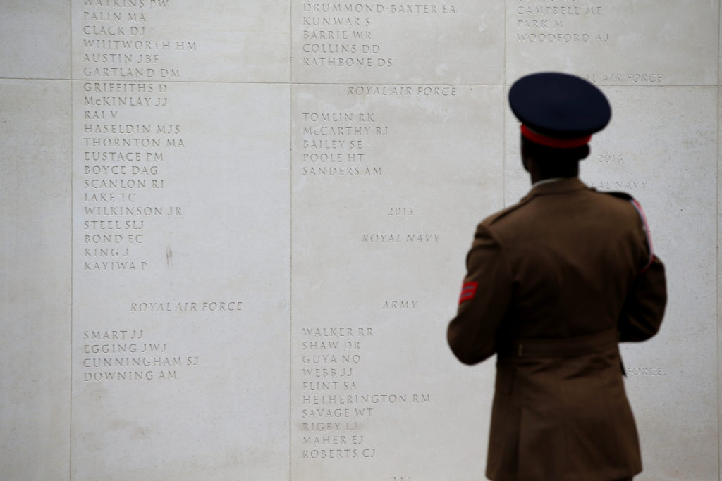 A member of Queen Alexandra's Royal Army Nursing Corps stands in front of a wall at the National Memorial Arboretum on the 75th anniversary of D-Day, in Staffordshire, Britain. Photo by Andrew Yates/Reuters