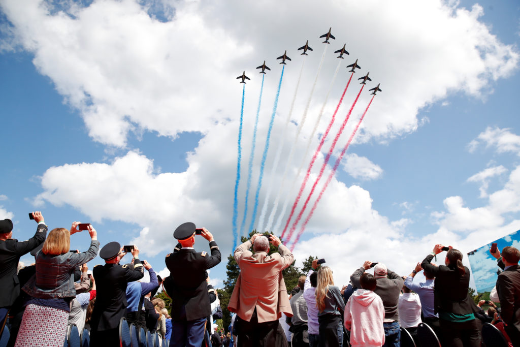 Jets from the French Air Force Patrouille de France fly during a ce…