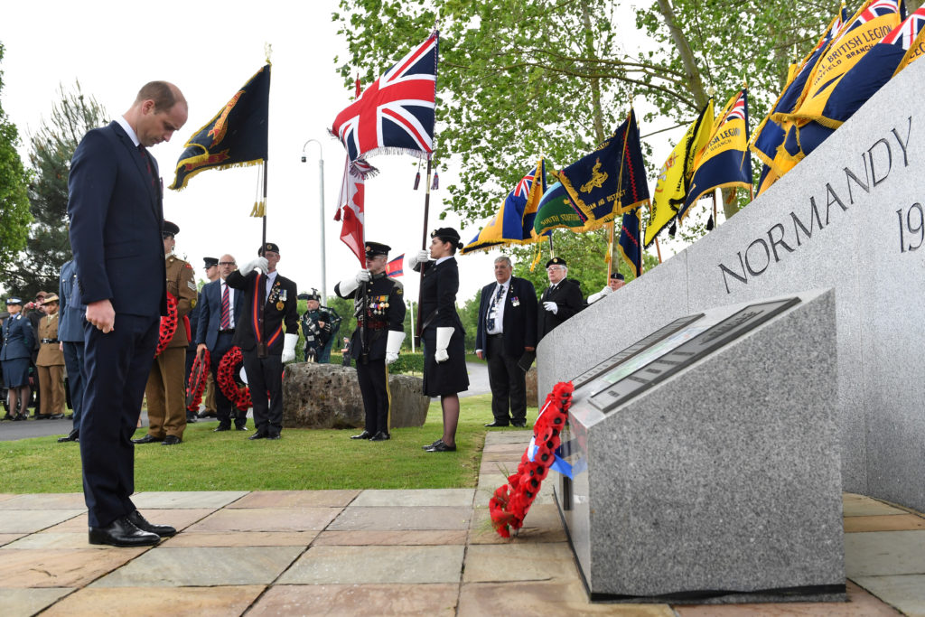 Britain's Prince William lays a wreath during a commemoration service at the National Memorial Arboretum in Alrewas, Staffordshire, Britain June 6, 2019. Photo by Anthony Devlin/Reuters