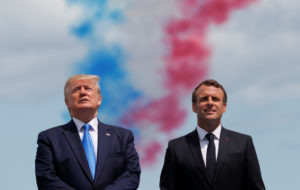 President Donald Trump and French President Emmanuel Macron look on in the Normandy American Cemetery to commemorate the 75th anniversary of the D-Day landings, Normandy, France. Photo by Carlos Barria/Reuters
