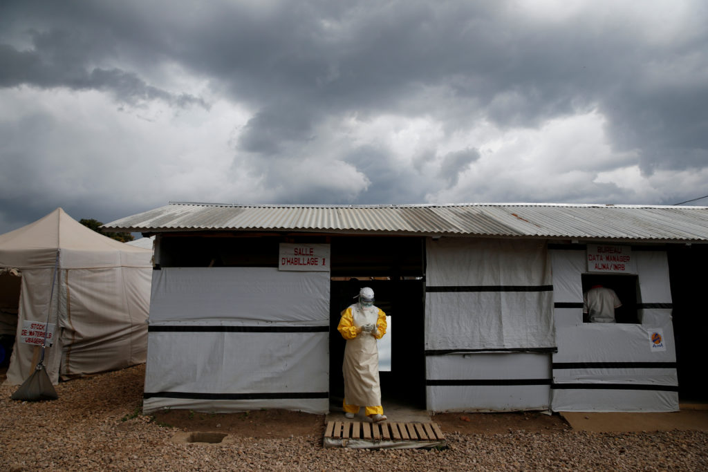 A health worker wearing Ebola protection gear, leaves the dressing room before entering the Biosecure Emergency Care Unit (CUBE) at the ALIMA (The Alliance for International Medical Action) Ebola treatment centre in Beni, in the Democratic Republic of Congo, March 30, 2019. Photo by Baz Ratner/Reuters