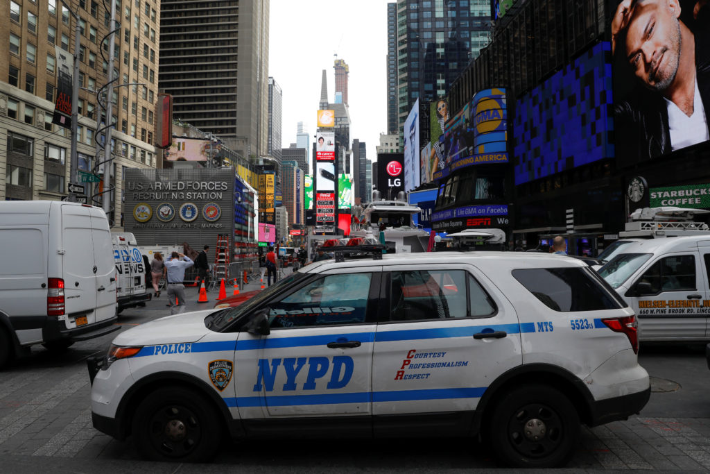 New York City Police Department (NYPD) vehicles patrol in Time Squa…