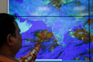 An India Meteorological Department scientist monitors Cyclone Vayu inside his office in Ahmedabad, India, June 11, 2019. Photo by Amit Dave/Reuters