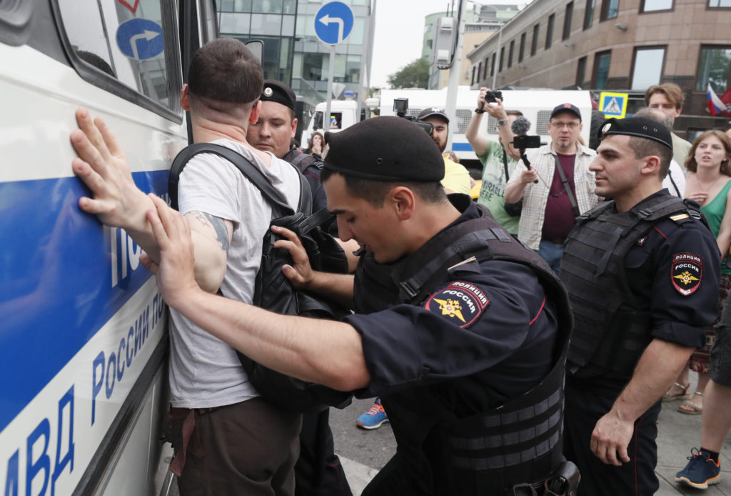 Law enforcement officers detain a participant of a rally in support of Russian investigative journalist Ivan Golunov, who was detained by police, accused of drug offences and later freed from house arrest, in Moscow, Russia June 12, 2019. Photo by Shamil Zhumatov/Reuters