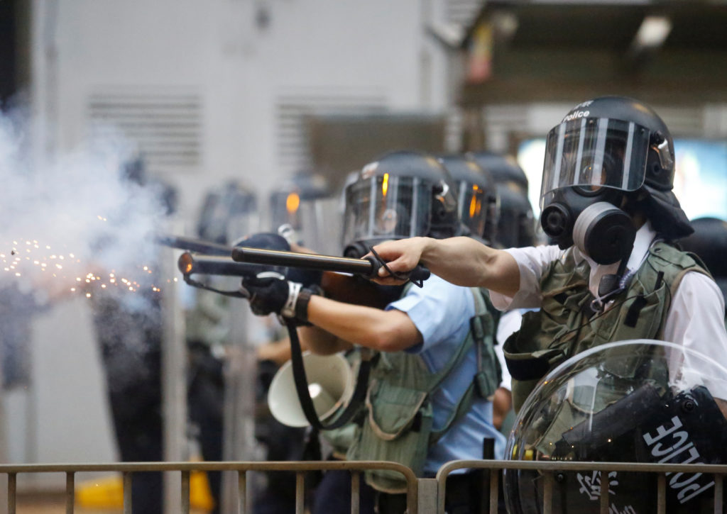 Police officers fire tear gas during a demonstration against a prop…