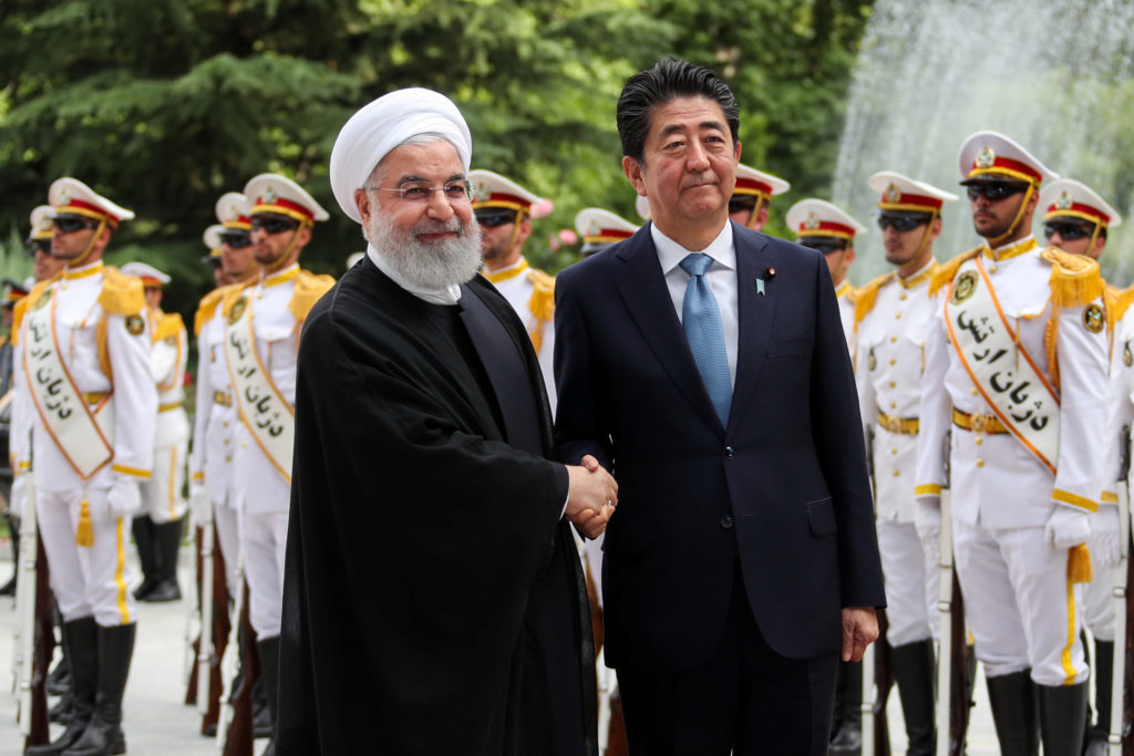 Iranian President Hassan Rouhani shakes hands with Japan's Prime Minister Shinzo Abe, during a welcome ceremony in Tehran, Iran, on June 12, 2019. Photo courtesy: Official Iranian President website/Handout via Reuters