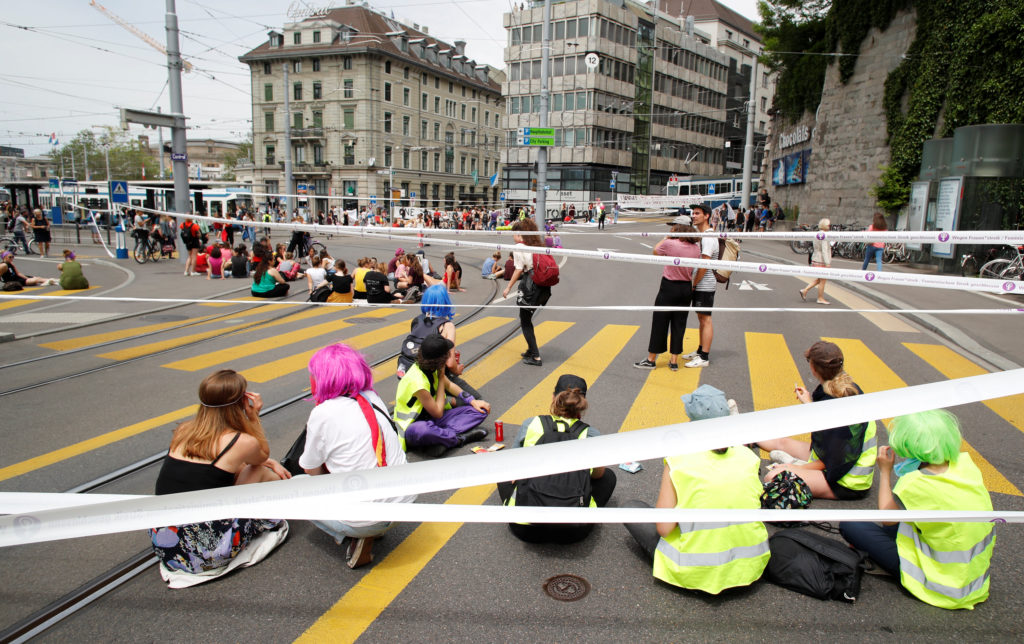 The traffic is blocked by the participants of a women's strike (Frauenstreik) at the Central Square in Zurich, Switzerland on June 14, 2019. Photo by Arnd Wiegmann/Reuters