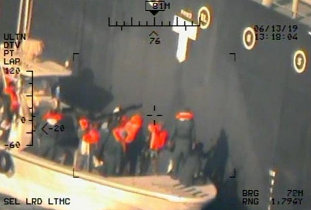 A U.S. military image released by the Pentagon in Washington on June 17, shows personnel that the Pentagon says are members of the Islamic Revolutionary Guard Corps Navy removing an unexploded limpet mine from a Japanese owned commercial motor tanker. Photo by U.S. Navy via Reuters