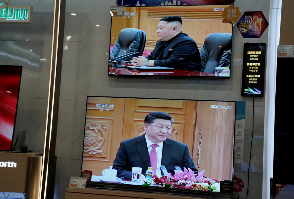 Television screens show Chinese state media CCTV's footage of North Korean leader Kim Jong Un's meeting with Chinese President Xi Jinping, at an electronics store in Beijing, China. Photo by Jason Lee/Reuters