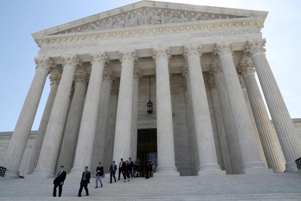 People leave the U.S. Supreme Court in Washington, D.C, on June 17, 2019. Photo by Leah Millis/Reuters