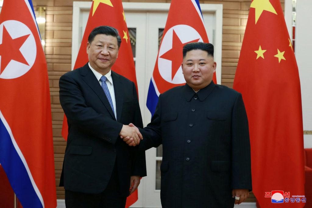 North Korean leader Kim Jong Un shakes hands with China's President…