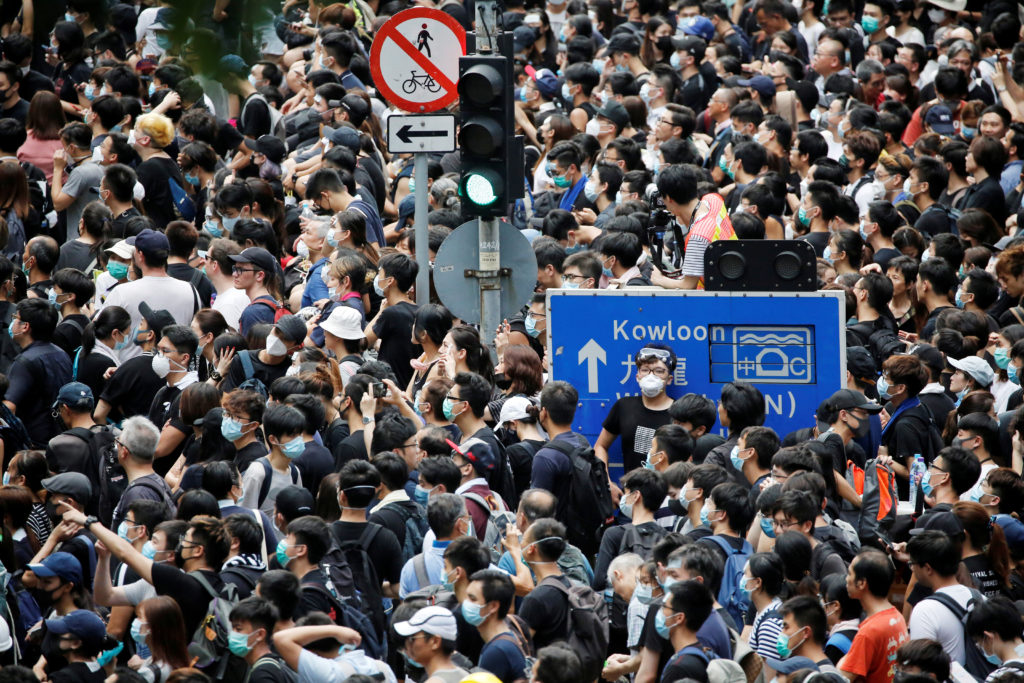 People protest outside police headquarters, demanding Hong Kong's leaders to step down and withdraw the extradition bill, ...