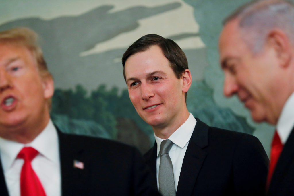 FILE PHOTO: White House senior advisor Jared Kushner smiles while listening to U.S. President Donald Trump talk as the president meets with Israel's Prime Minister Benjamin Netanyahu at the White House in Washington, on March 25, 2019. Kushner has been a key player in developing the Middle East peace plan. Photo by Carlos Barria/Reuters