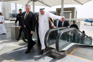 Secretary of State Mike Pompeo comes off an escalator with Saudi Foreign Minister Ibrahim Abdulaziz Al-Assaf, as Pompeo arrives in Jeddah, Saudi Arabia June 24, 2019. Photo by Jacquelyn Martin/Pool via Reuters