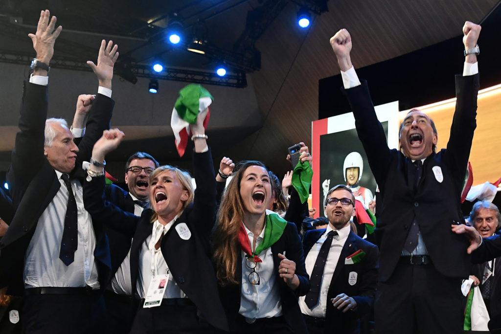 Delegation members representing Milan Cortina celebrate after the city won the bid to host the 2026 Winter Olympic Games during the 134th Session of the International Olympic Committee (IOC), at the SwissTech Convention Centre, in Lausanne, Switzerland on June 24, 2019. Photo by Philippe Lopez/Pool via Reuters