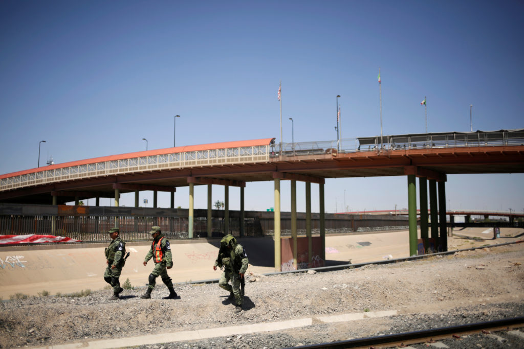 Members of Mexico's National Guard patrol the border between Mexico…