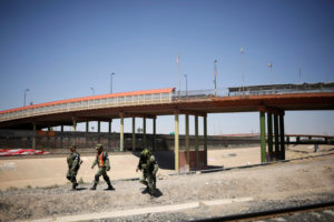 Members of Mexico's National Guard patrol the border between Mexico and the U.S. as part of an ongoing operation to prevent migrants from crossing illegally into the United States, in Ciudad Juarez, Mexico on June 24, 2019. Photo Jose Luis Gonzalez/Reuters