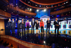 Democratic 2020 presidential candidates New York City Mayor Bill de Blasio, U.S. Rep. Tim Ryan, former HUD Secretary Julian Castro, U.S. Senator Cory Booker, U.S. Senator Elizabeth Warren, former U.S. Rep. Beto O'Rourke, Senator Amy Klobuchar, U.S. Rep. Tulsi Gabbard, Washington Governor Jay Inslee and former U.S. Rep. John Delaney pose together before the start of the first U.S. 2020 presidential election Democratic candidates debate in Miami, Florida, U.S., June 26, 2019. Photo by REUTERS/Carlo Allegri