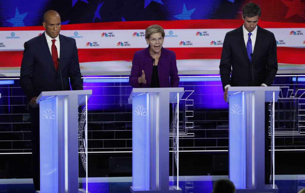 U.S. Senator Cory Booker and former U.S. Rep. Beto O'Rourke listen …