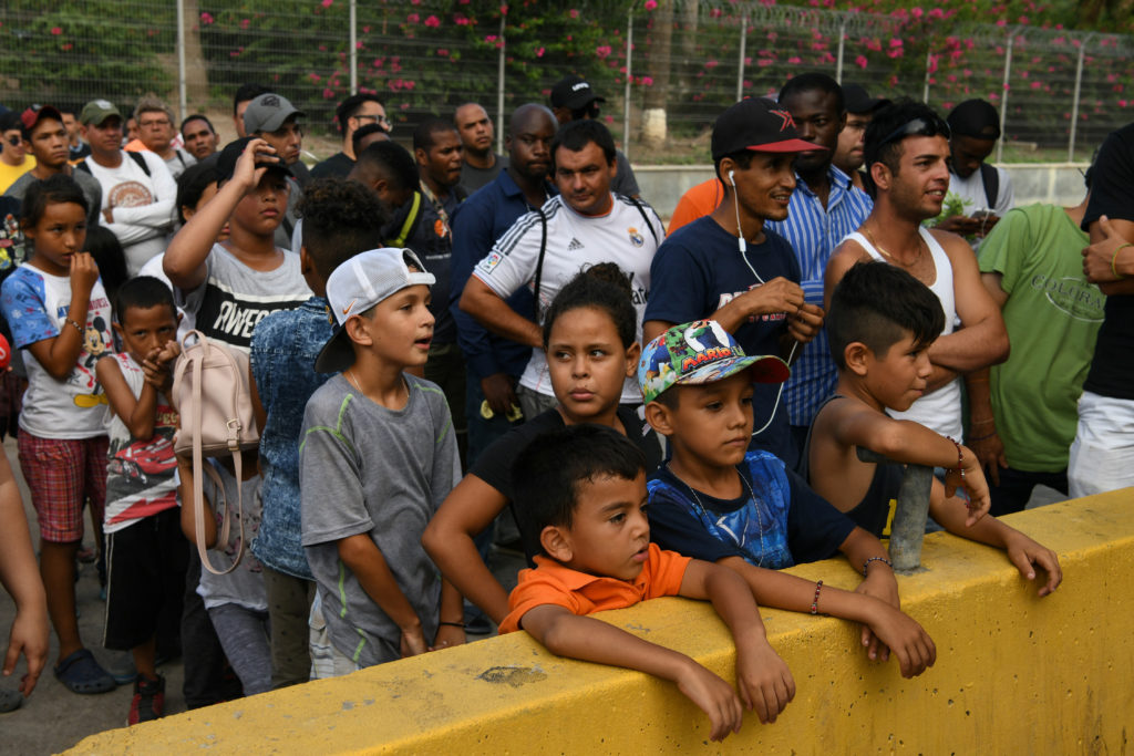 Asylum seekers waiting in hopes of being let through the nearby U.S…