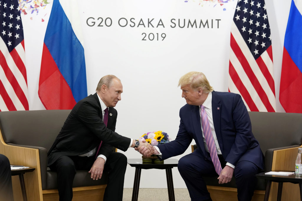 Russia's President Vladimir Putin and U.S. President Donald Trump shake hands during a bilateral meeting at the G20 leader...