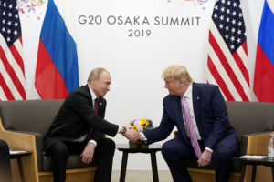 Russia's President Vladimir Putin and U.S. President Donald Trump shake hands during a bilateral meeting at the G20 leaders summit in Osaka, Japan. Photo by Kevin Lamarque/Reuters