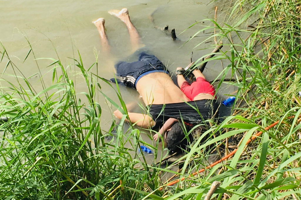 The bodies of Salvadoran migrant Oscar Alberto Martínez Ramírez and his nearly 2-year-old daughter Valeria lie on the bank of the Rio Grande in Matamoros, Mexico, Monday, June 24, 2019, after they drowned trying to cross the river to Brownsville, Texas. Martinez' wife, Tania told Mexican authorities she watched her husband and child disappear in the strong current. AP Photo/Julia Le Duc