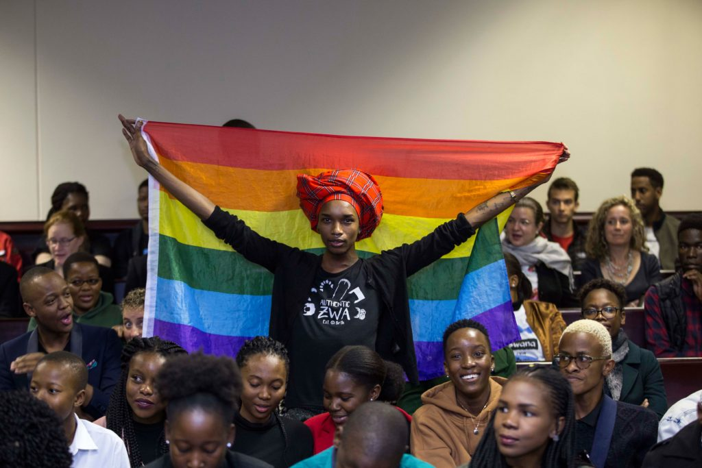 An activist holds up a rainbow flag to celebrate inside Botswana High Court in Gaborone on June 11, 2019. - Botswana's Court ruled on June 11 in favour of decriminalising homosexuality, handing down a landmark verdict greeted with joy by gay rights campaigners. Photo by Tshekiso Tebalo/AFP/Getty Images