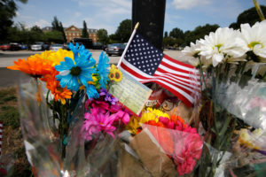 A card lists the names of the victims at a makeshift memorial outside a municipal government building where a shooting incident occurred in Virginia Beach, Virginia. Photo by Jonathan Drake/Reuters
