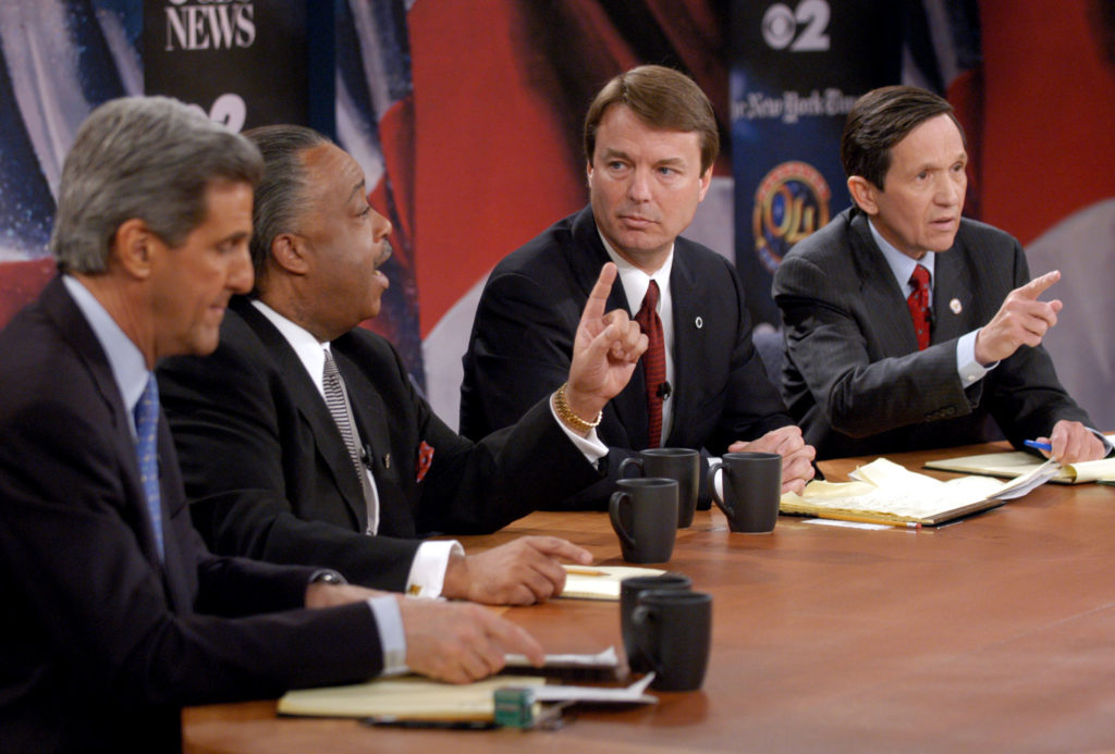 Rev. Al Sharpton (2nd L) speaks as Senator John Kerry (L), Senator John Edwards (2nd R) and Rep. Dennis Kucinich (D-Oh) listen at the debate between Democratic presidential rivals at the CBS Broadcast Center in New York on February 29, 2004. Sharpton criticized debate organizers and the panel for what he said was preferential treatment given to Kerry and Edwards as the four remaining candidates for the Democratic presidential nomination met for the final debate before the crucial March 2 'Super Tuesday' caucuses and primaries. REUTERS/John Filo/Pool US ELECTION PM - RP4DRIBSBEAA
