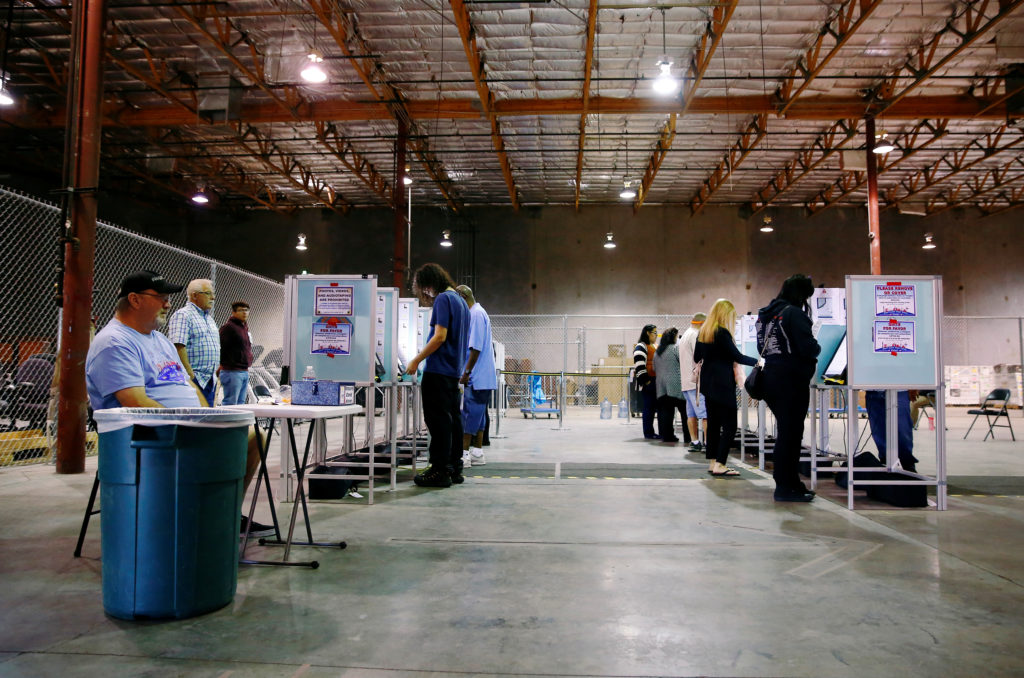 Voters take to the polls at a location near the Las Vegas Strip during the midterm election in Las Vegas, Nevada, U.S., No...