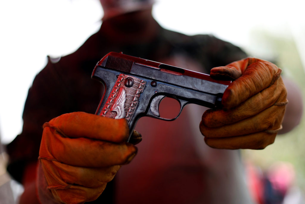 A soldier shows a gun delivered by a citizen as part of a voluntary disarmament program in Mexico City, Mexico April 3, 2019.REUTERS/Edgard Garrido - RC17402D1250