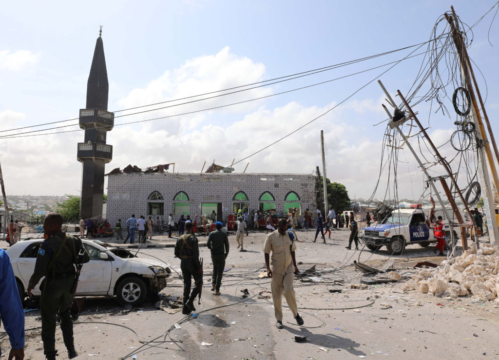 Somali security officers secure the scene of a suicide car explosion at a checkpoint near the Somali Parliament building in Mogadishu, Somalia June 15, 2019 Photo by Feisal Omar/Reuters