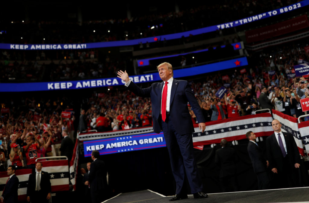 U.S. President Donald Trump reacts on stage formally kicking off hi…