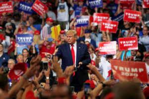 U.S. President Donald Trump reacts with supporters formally kicking off his re-election bid with a campaign rally in Orlando, Florida, U.S., June 18, 2019. REUTERS/Carlos Barria - RC142DE37DC0