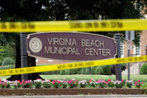 Police tape frames a sign at one of the entrances to the municipal government complex where a shooting incident occurred in Virginia Beach, Virginia, U.S. June 1, 2019. Photo By Jonathan Drake/Reuters