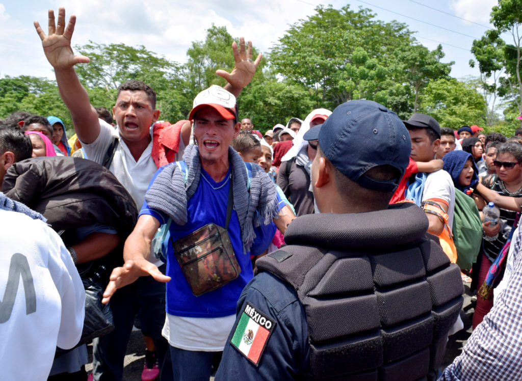 Migrants gesture while arguing with a federal police officer during a joint operation by the Mexican government to stop a caravan of Central American migrants on their way to the U.S., at Metapa de Dominguez, in Chiapas state, Mexico June 5, 2019. Photo by Jose Torres/Reuters