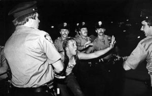 Police clash with a protestor at Stonewall in 1969. Photo by Bettye Lane, via First Run Features