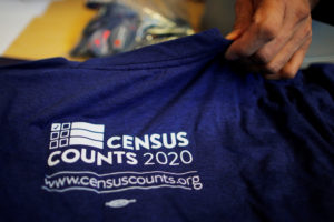 T-shirts are displayed at a community activists and local government leaders event to mark the one-year-out launch of the 2020 Census efforts in Boston, Massachusetts, U.S., April 1, 2019. Photo by REUTERS/Brian Snyder