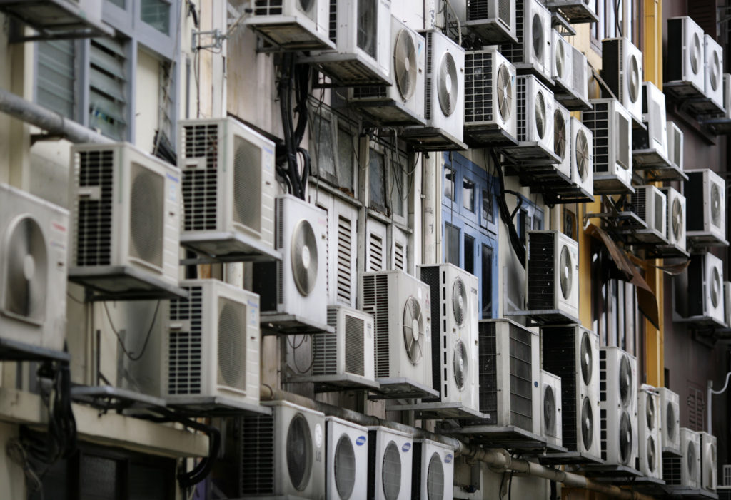 Rows of air conditioners are seen on the walls of a building in Singapore's financial district December 11, 2009. Photo by REUTERS/Vivek Prakash