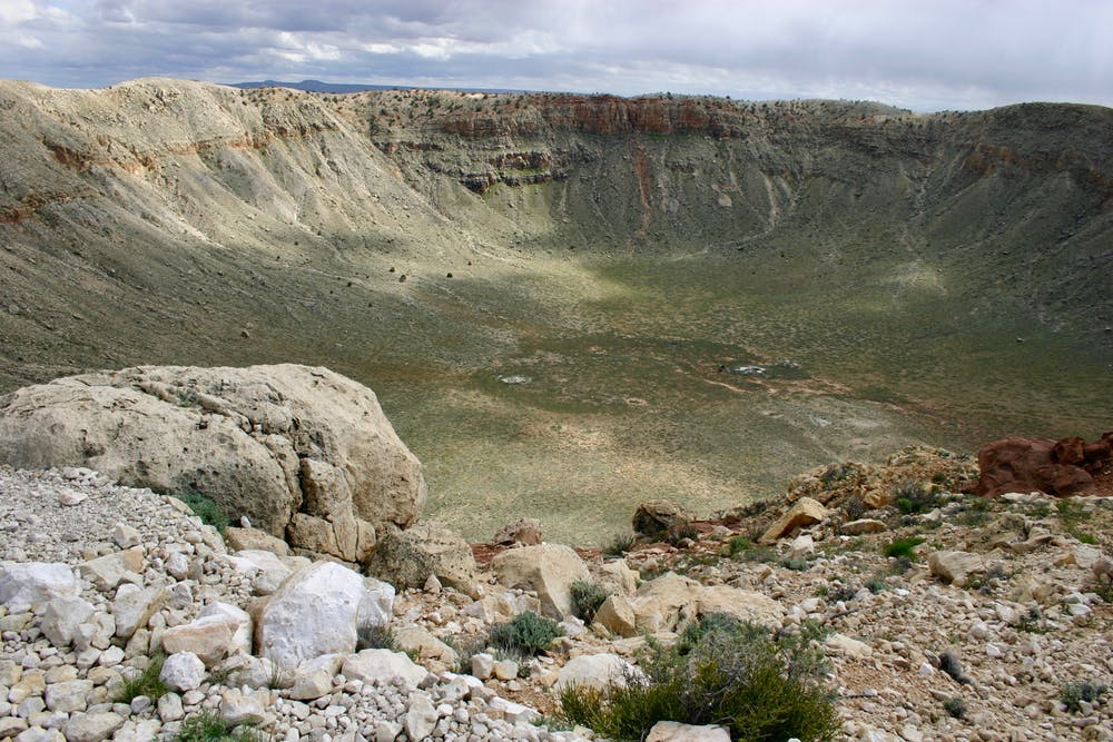 This meteor crater in Arizona was created 50,000 years ago when an iron meteorite struck the Earth. It is about one mile across. Photo by W. Herbst, CC BY-SA