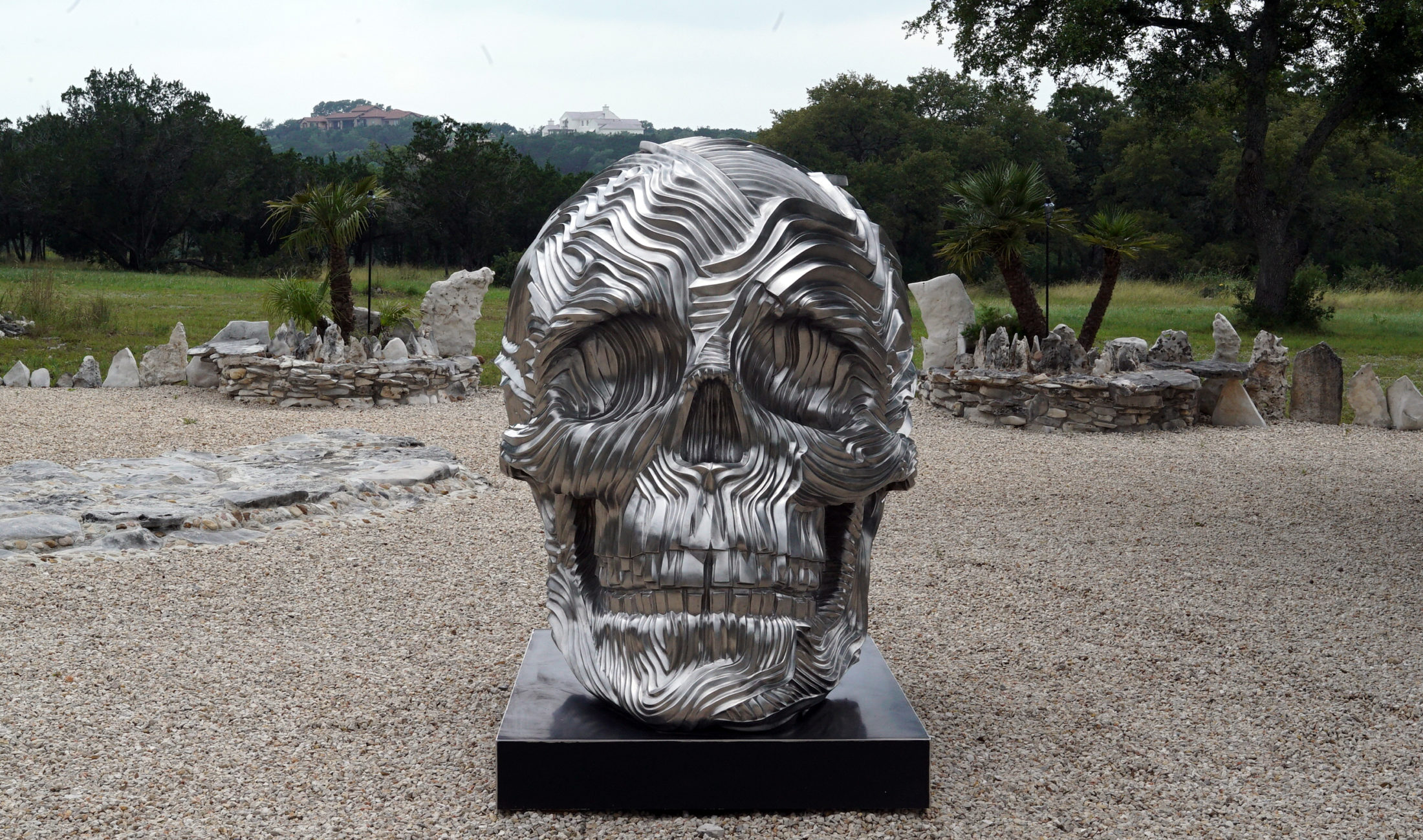 "Bruvel's ""The Descent, Monumental,"" which sits outside his home in Wimberley, Texas. Photo by Joshua Barajas/PBS NewsHour"