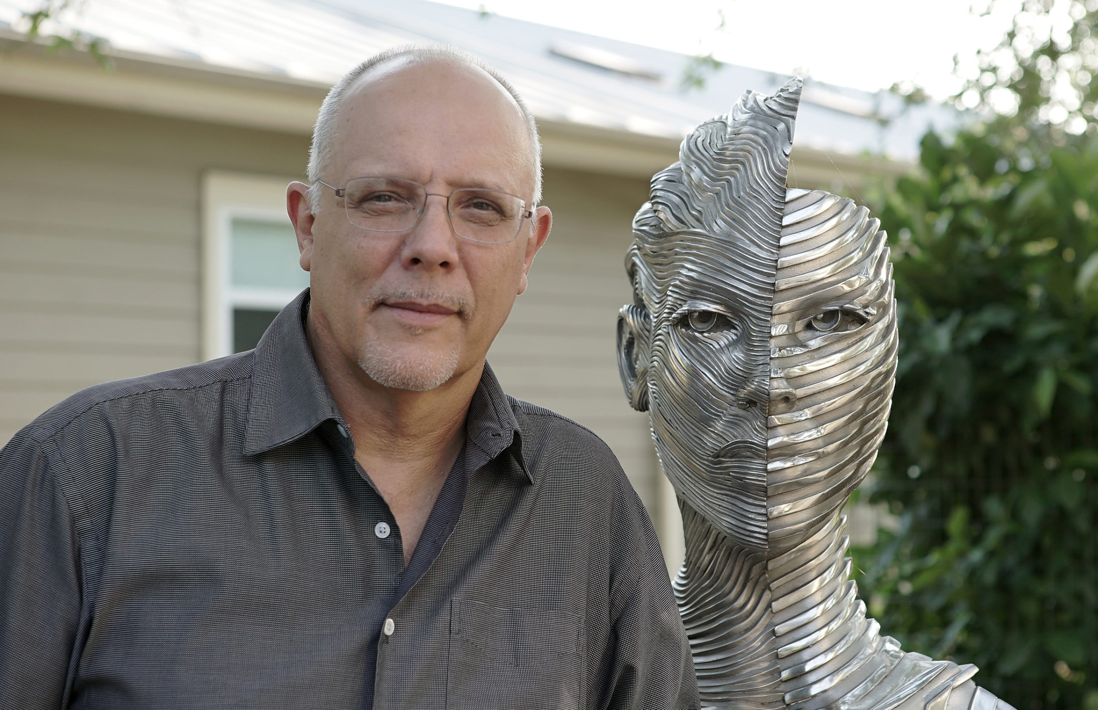 Bruvel next to one of his steel sculptures. Photo by Joshua Barajas/PBS NewsHour