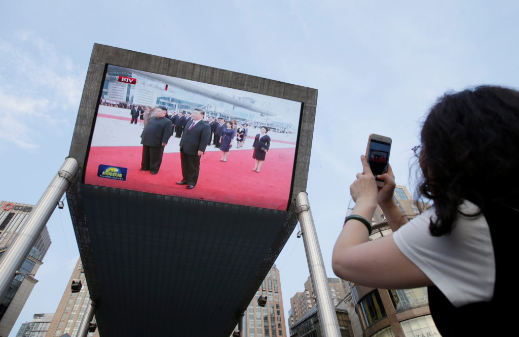 A television screen shows Chinese state media CCTV's footage of North Korean leader Kim Jong Un's meeting with Chinese President Xi Jinping in Pyongyang, in Beijing, China June 20, 2019. REUTERS/Jason Lee