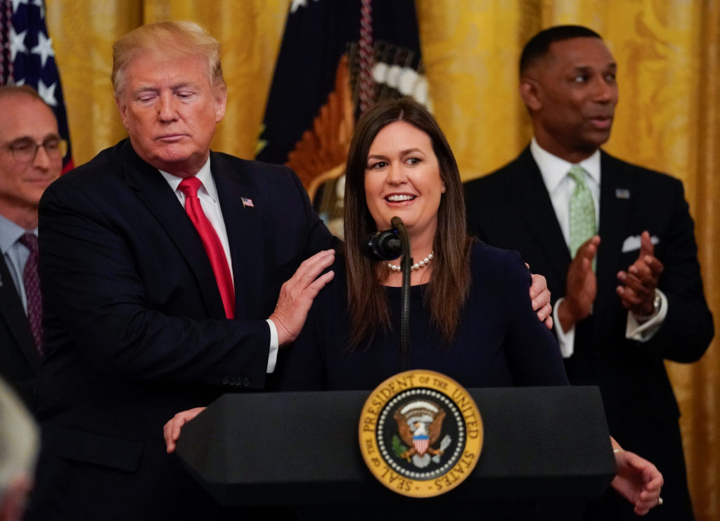 U.S. President Donald Trump embraces White House Press Secretary Sarah Sanders after it was announced she will leave her job at the end of the month, during a second chance hiring prisoner reentry event in the East Room of the White House in Washington, U.S., June 13, 2019. REUTERS/Kevin Lamarque