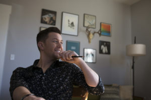 "The former ""American Idol"" winner has a string of country hits, but was dropped by his label in 2016, a low point for the young country music star. But, from there, ""I just kept taking one step at a time,"" he told the NewsHour. He released a new album last year. Photo by Jeff Ray"