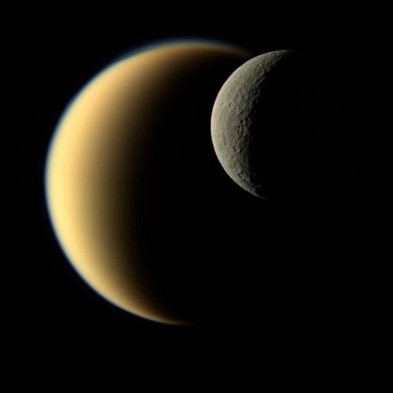Saturn's icy moon Rhea passes in front of Titan as seen by NASA's Cassini spacecraft in 2009. Image by NASA/JPL-Caltech/Space Science Institute