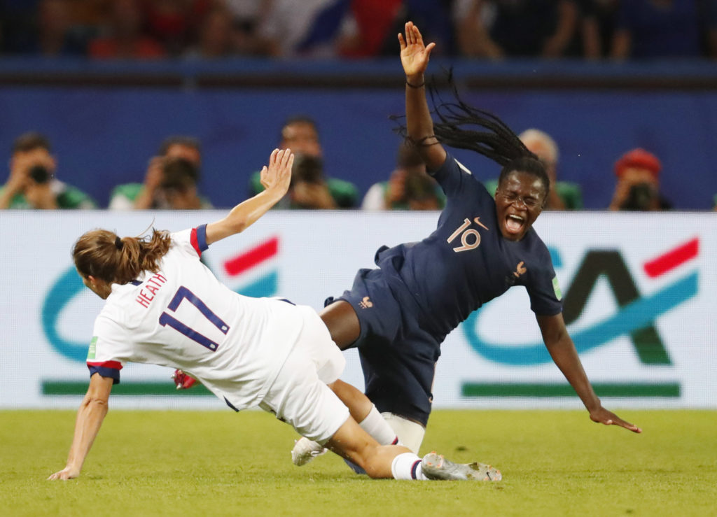 France defender Griedge Mbock Bathy (19) is tripped by United States forward Tobin Heath (17)  in the second half of a quarterfinal match in the FIFA Women's World Cup France 2019 at Parc des Princes. Michael Chow-USA TODAY Sports