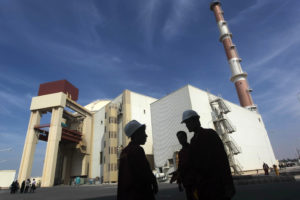 FILE PHOTO: Iranian workers stand in front of the Bushehr nuclear power plant, about 1,200 km (746 miles) south of Tehran October 26, 2010. Photo by Mehr News Agency/Majid Asgaripour/ via Reuters